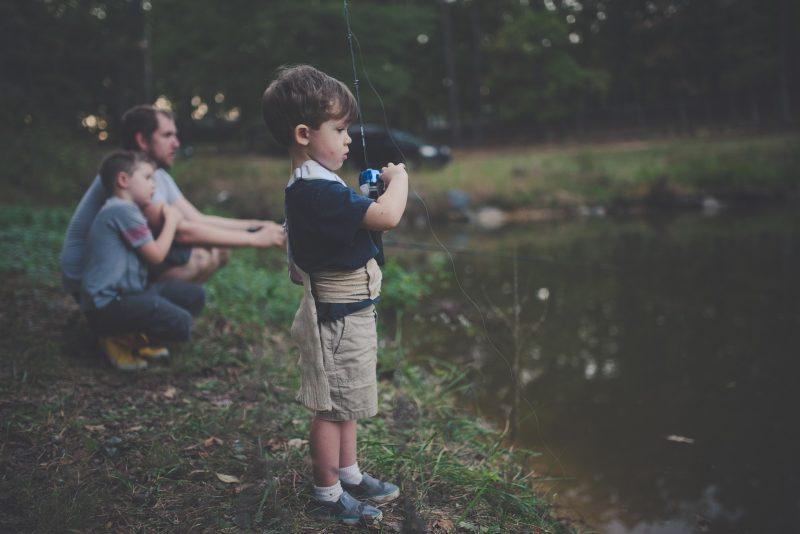 kid is fishing